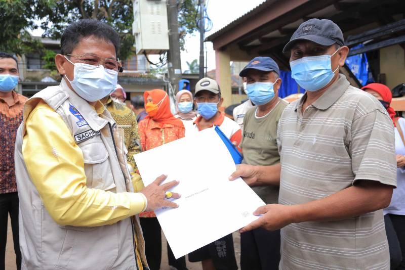 IMG-peduli-solusi-urus-berkas-kependudukan-pasca-banjir